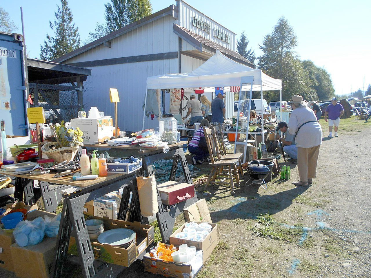 Shoppers look for bargains at last year's Great Strait Sale on state Highway 112 in Joyce. Despite a detour for culvert work in Pysht, organizers said the annual event will go on in many towns, including Joyce, Clallam Bay, Sekiu and Neah Bay. (Sande Balch)