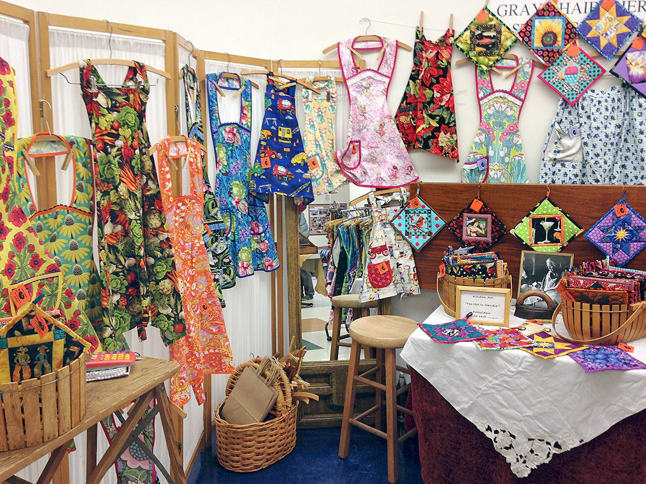 About 50 vendors will set up shop today and Saturday during the 26th annual Holiday Arts and Crafts Fair. Shown are aprons crafted by Jean McCrea of Port Townsend during the 2015 fair. (Port Townsend Arts Guild)