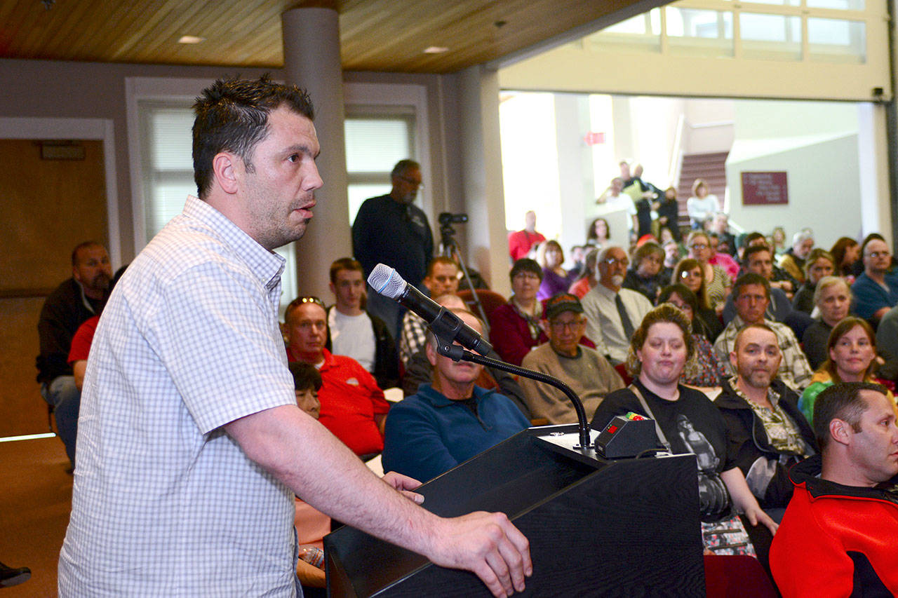 Chad Westenhaver, chair of the Port Angeles Oxford House chapter, asks how the city can help Oxford House, which provides housing for recovering addicts, expand in Port Angeles. (Jesse Major/Peninsula Daily News)