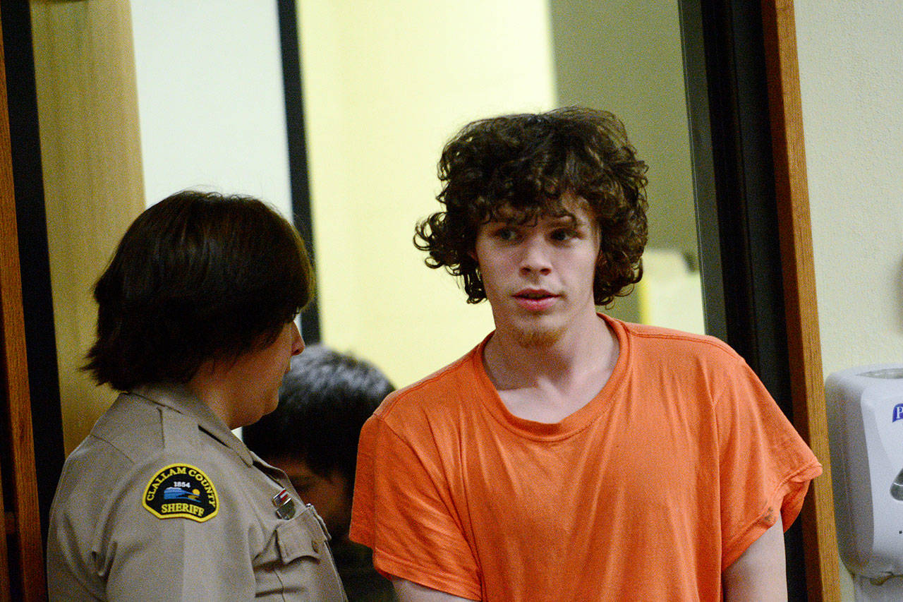 Joseph Warren Recoy, 24, is escorted into Clallam County Superior Court on Tuesday. (Jesse Major/Peninsula Daily News)