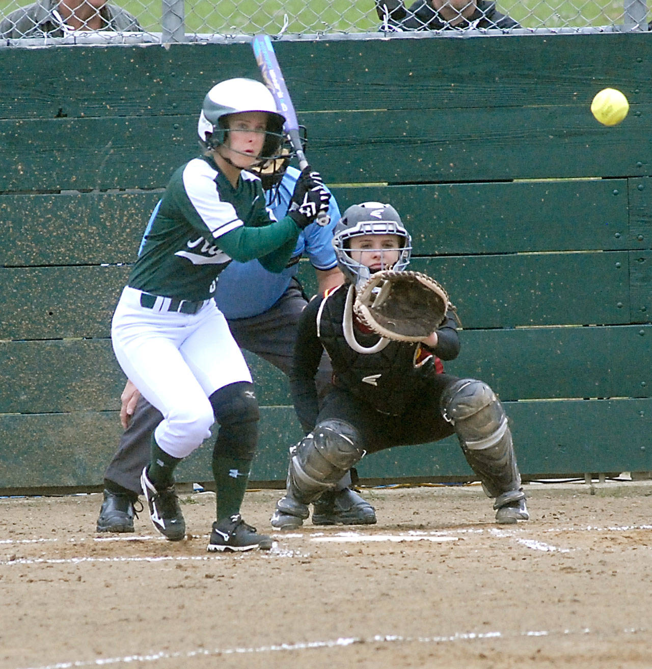 Keith Thorpe/Peninsula Daily News                                Port Angeles' Sierra Robinson bats as Kingston catcher Meghan Fenwick waits for the delivery during their May 9 game at the Dry Creek athletic fields.