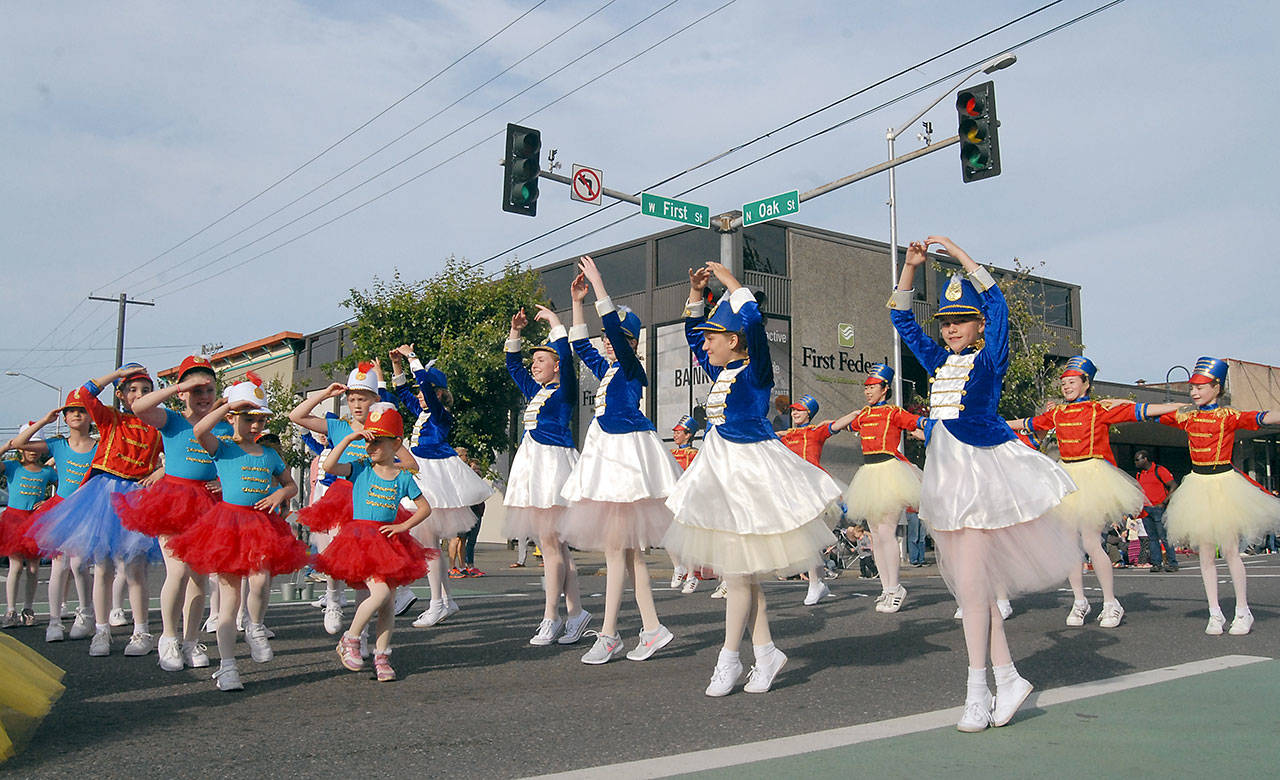 Members of Ballet Workshop of Port Angeles dance in the streets during Thursday's Independence Day parade. (Keith Thorpe/Peninsula Daily News)