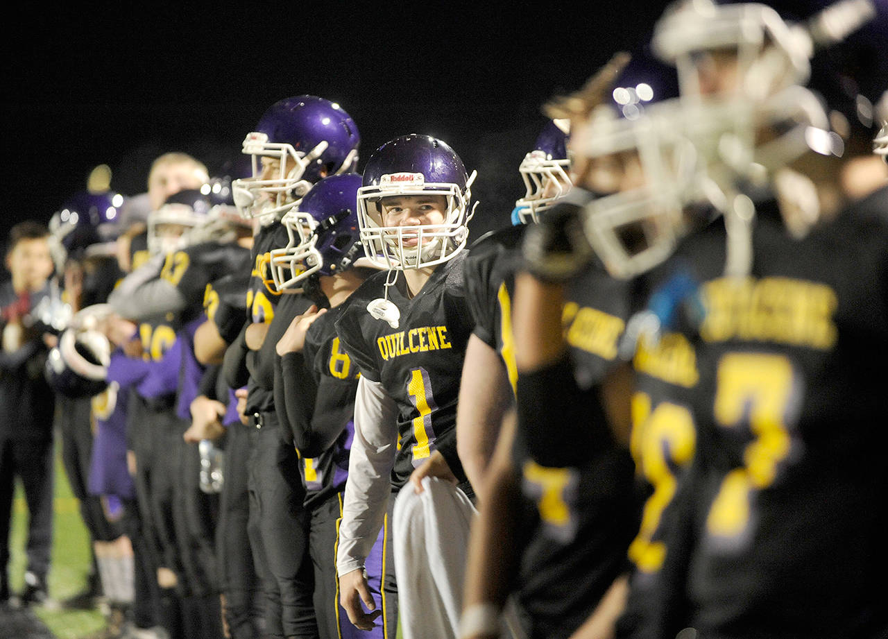 Quilcene's Chase Newman, 1, and his teammates line up before a district playoff game last season. (Michael Dashiell/Olympic Peninsula News Group)