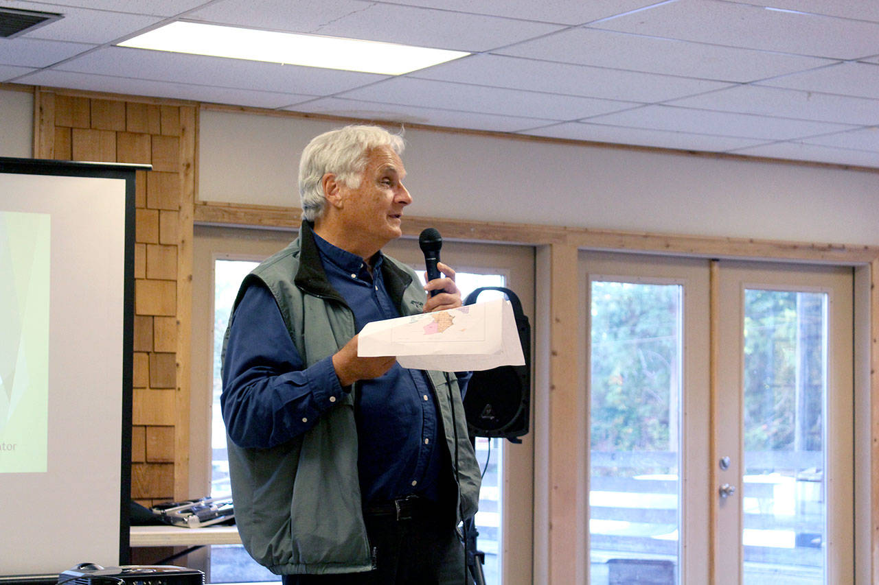 During a community outreach meeting in Quilcene, Jefferson County Assessor Jeff Chapman explains the process of assessing property in the county and invites those who don't agree with their assessed value to talk with his team to come to an agreement. (Zach Jablonski/Peninsula Daily News)
