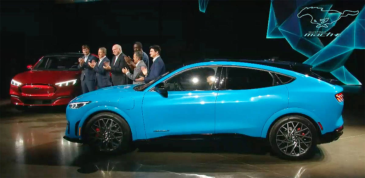 Ford Motor Company executives and actor Idris Elba celebrate the unveiling of the Mustang Mach E in an online event Sunday. Ford Motor Company/YouTube