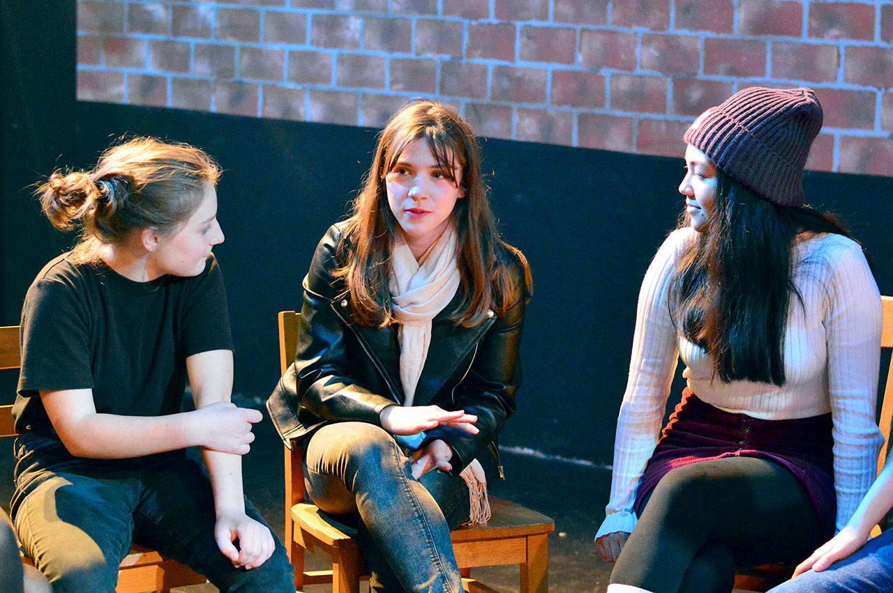 "Cast members, from left, Trillium Burbank, 14, Pascale Sanok, 15, and Julia Neville, 16, discuss ""Our Town,"" the fall play at Port Townsend High School. (Diane Urbani de la Paz)"