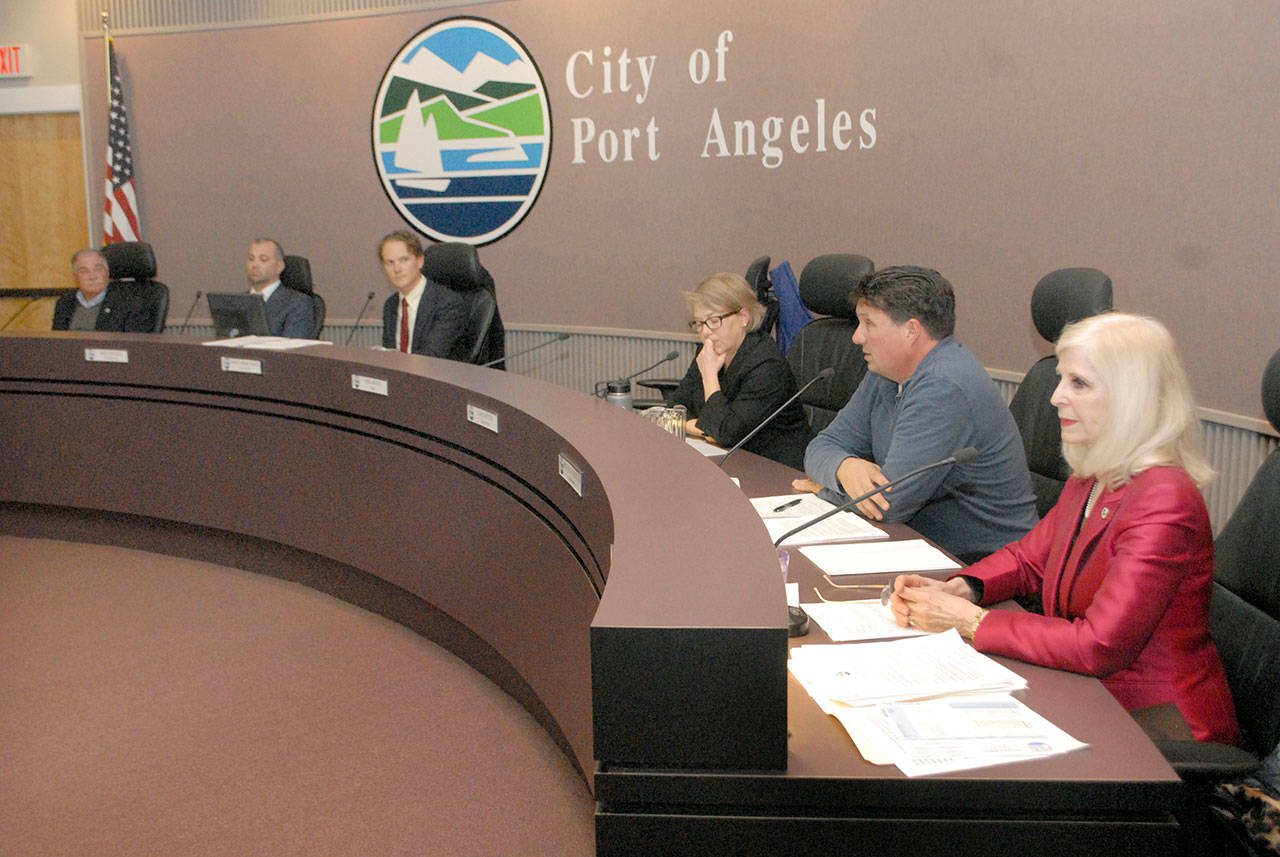 Port Angeles Deputy Mayor Kate Dexter, center, conducts Wednesday's city council meeting next to an empty seat that was occupied by Mayor Sissi Bruch after Bruch recused herself from a council motion and discussion to strip her mayoral title. (Keith Thorpe/Peninsula Daily News)