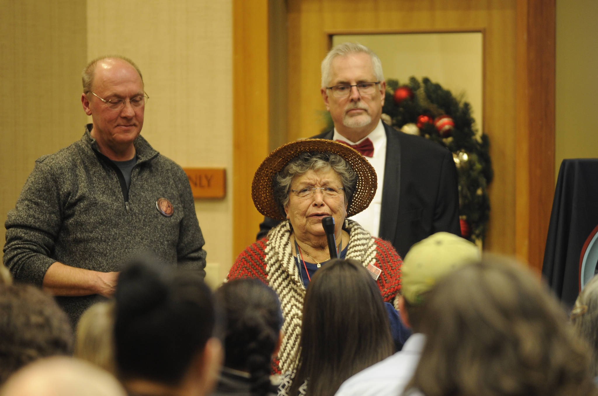 Jamestown S'Klallam Tribe storyteller Elaine Grinnell speaks at the tribe's MAT clinic design unveiling in Sequim. Behind her are, left, Bud Turner, manager of the Jamestown S'Klallam carving shed and Brent Simcosky, the tribe's health services director. Michael Dashiell/Olympic Peninsula News Group