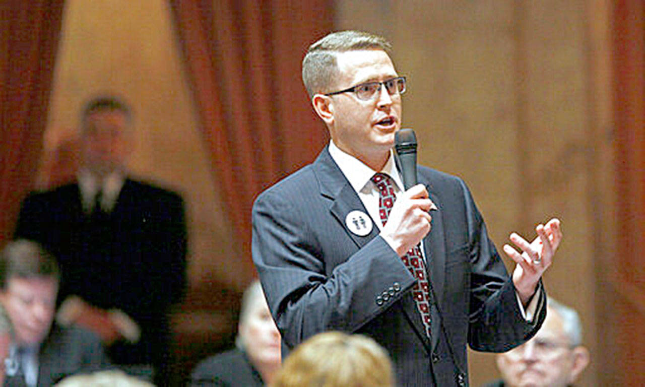 """In this Feb. 8, 2012, file photo, state Rep. Matt Shea, R-Spokane Valley, speaks at the Capitol in Olympia. Shea, a right-wing lawmaker from Washington state said that a recent report that branded him a ''domestic terrorist"""" is a lie and that he will continue to represent the people of his district. (AP Photo/Elaine Thompson, File)"""