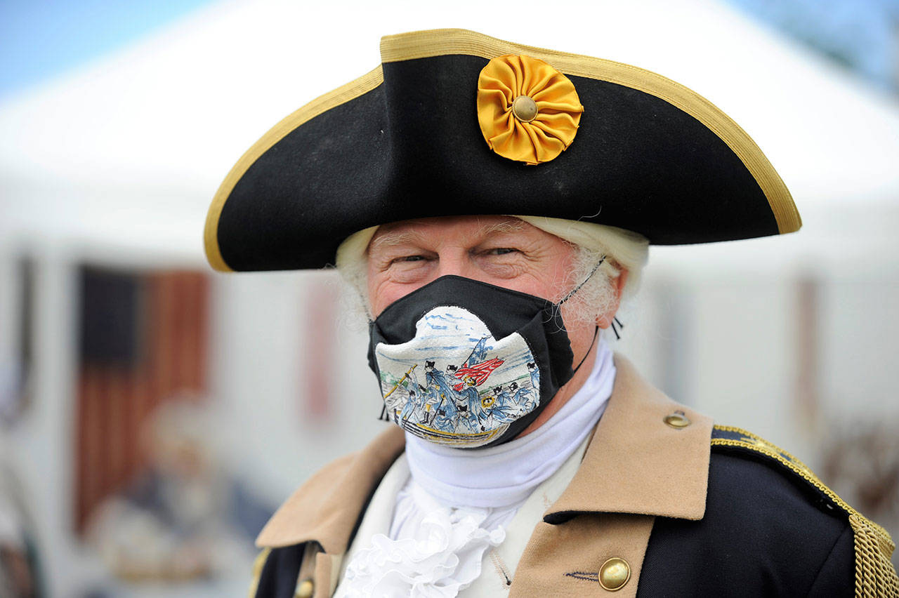 Vern Frykholm, a mainstay at the Northwest Colonial Festival portraying George Washington, shows off his mask made by Pam Gassman of Tacoma. He said with COVID-19 regulations in place, he and other portrayers are looking into creating educational podcasts and Zoom calls for schools/classrooms. (Matthew Nash/Olympic Peninsula News Group)