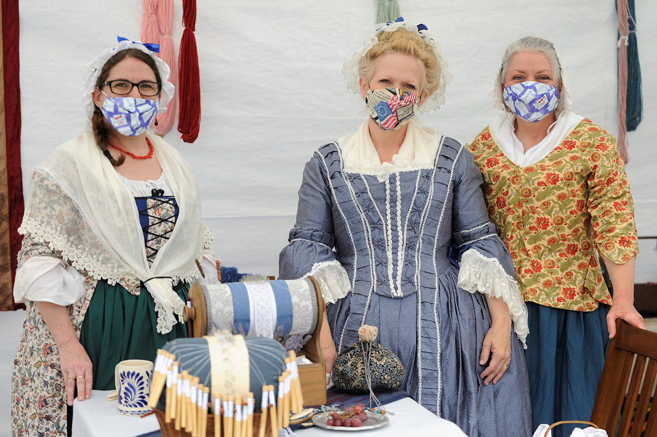 Members of the Mary Ball chapter of the Daughters of the American Revolution, from left, Coral Hileman of Federal Way, Pam Gassman of Tacoma and Lori Gibson of Oakville, enjoy some time together as they discuss garments from the 1770s. (Matthew Nash/Olympic Peninsula News Group)