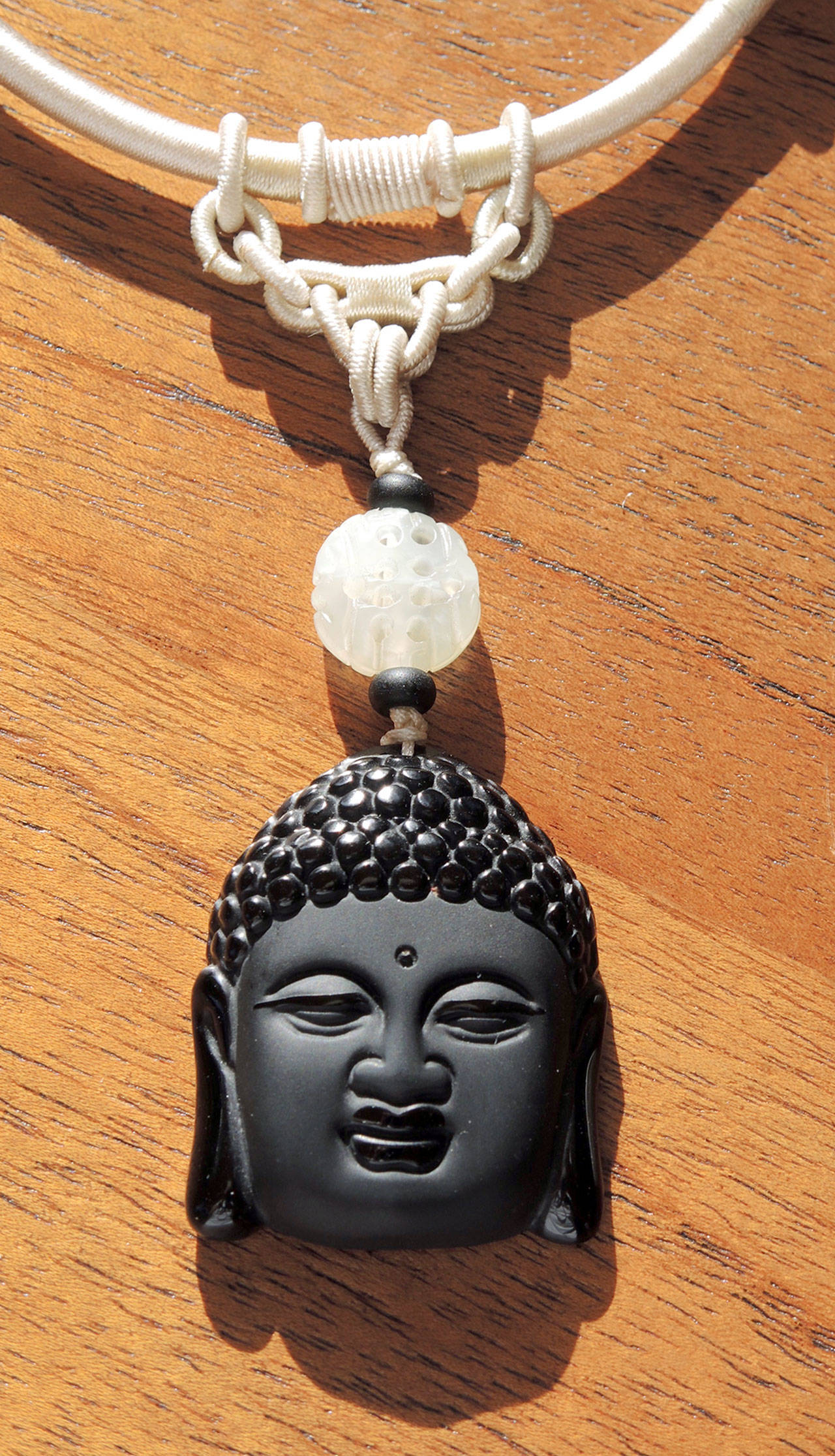 A Buddha head necklace is among the Port Ludlow Art Leagues Jeweler of the Month's designs.