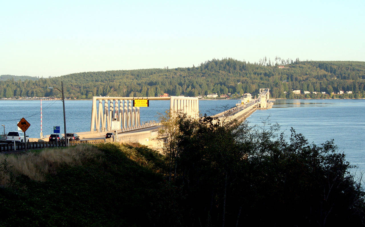 Traffic crosses the Hood Canal Bridge along state Highway 104 in this 2019 file photo. Endangered Species Act-listed Hood Canal steelhead are particularly impacted at the bridge, delayed by its design, as 50 percent of canal steelhead end up dying at the bridge. (Brian McLean/Peninsula Daily News)