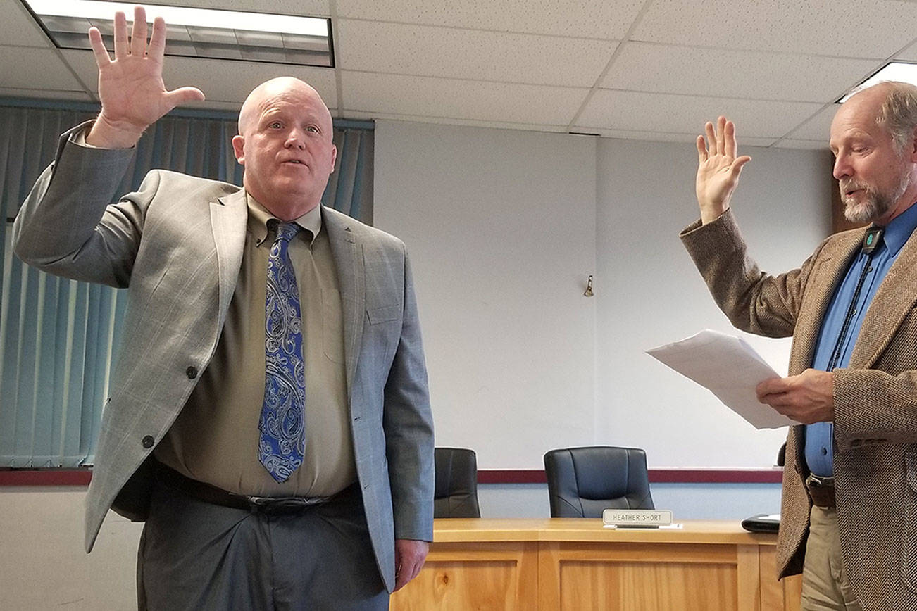 Rob Clark is officially sworn in as the interim superintendent of the Sequim School District by Judge Brian Coughenour in August 2019. Clark on leave as of Oct. 22 pending the outcome of a complaint, school district officials said this week. Sequim Gazette file photo by Conor Dowley