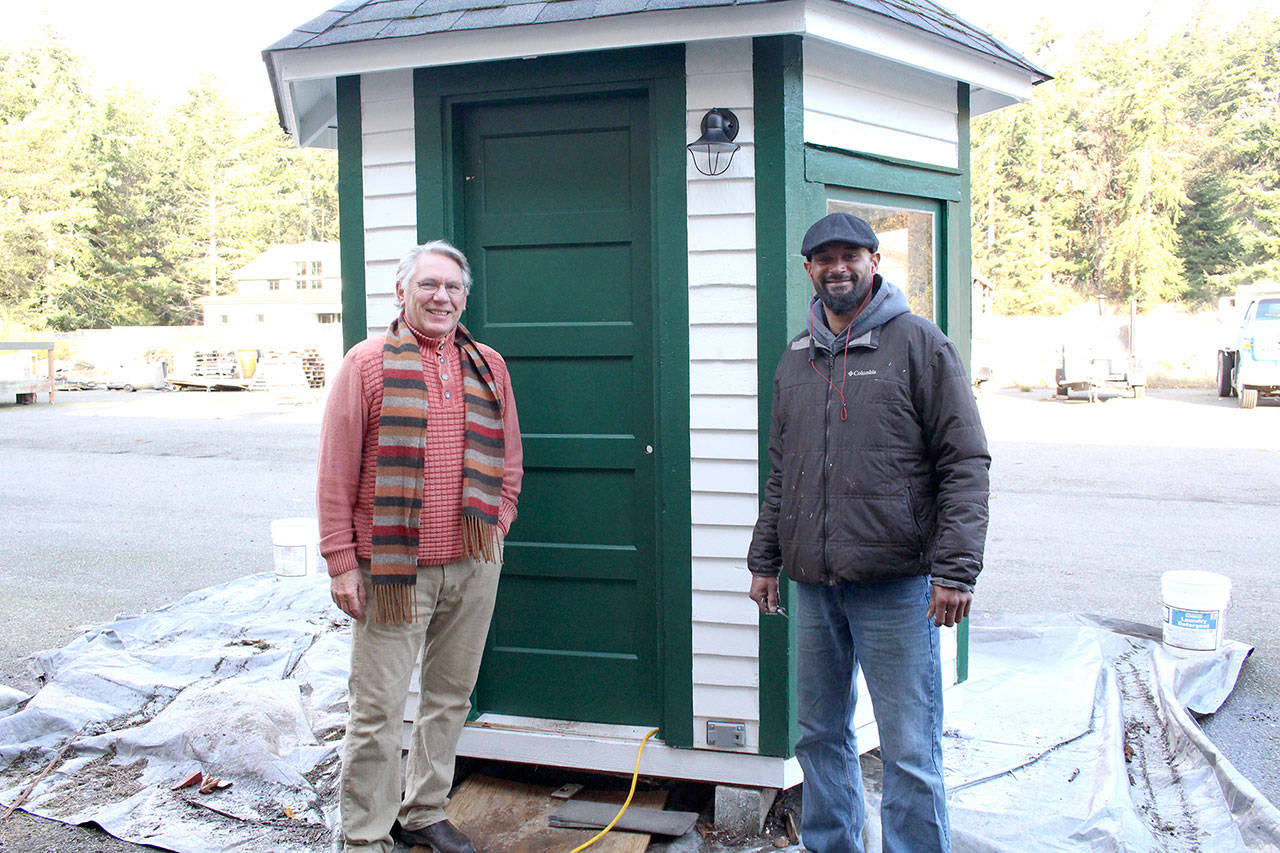 Friends of Fort Worden project lead and board member Bill Appleton, left, stands with local contractor Ty Hodge in front of the nearly completed restored guard shack that used to stand at the entrance of Fort Worden State Park when it was still used by the military. (Zach Jablonski/Peninsula Daily News)