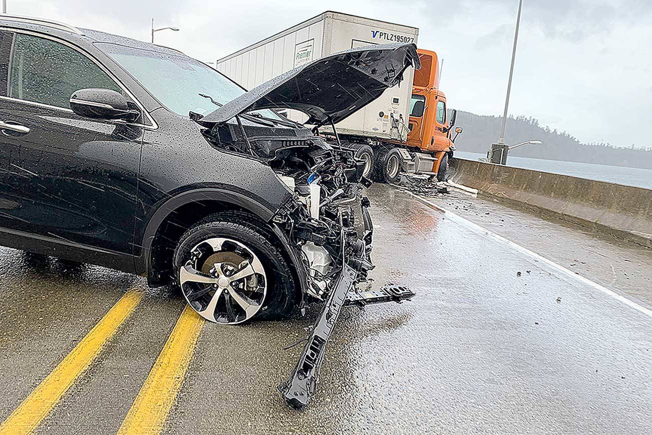 A head-on collision between a car and semi-truck closed the Hood Canal Bridge in both directions for nearly two hours on Tuesday morning.  (State Patrol)