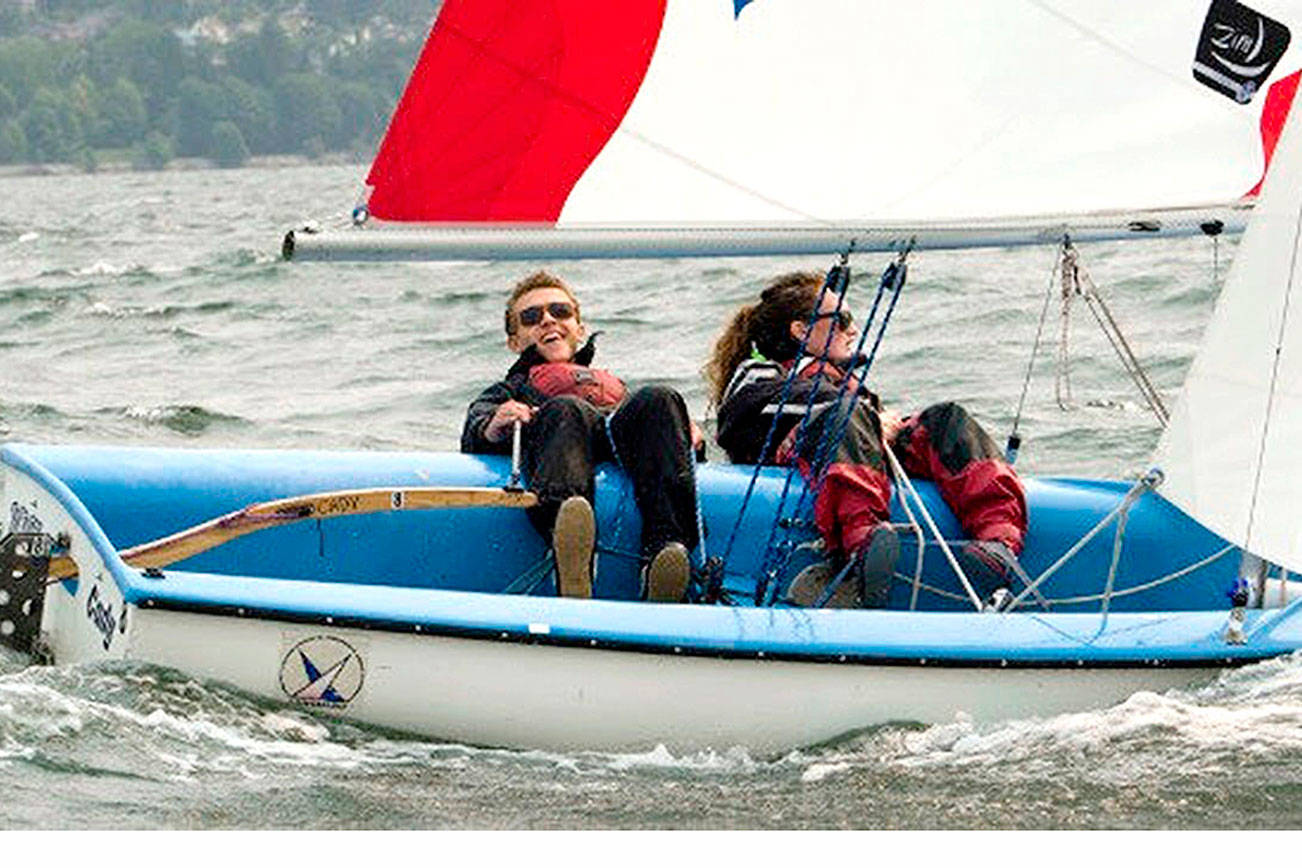 From left, Cedric Wesley Keneipp and Mallory Hood, both of Bellingham, sail in Bellingham Bay. They are part of Barely Legal Racing, a team of 19- to 22-year-olds that plan to compete in the Race to Alaska in 2021.