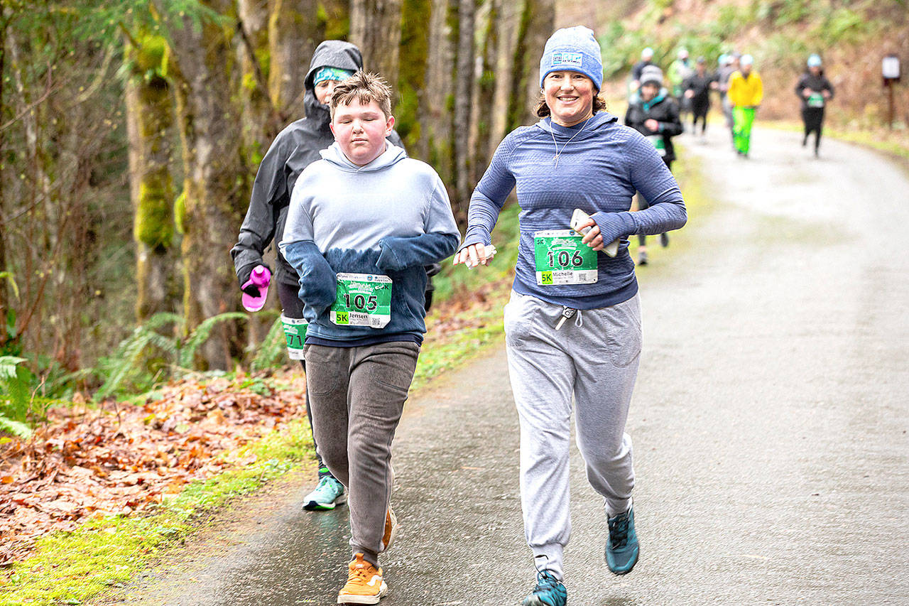 Run the Peninsula Jensen Wolfe, left, and Michelle Turner lead the pack in the 2020 Elwha River Bridge Run. The 2021 race will have a number of COVID-19 precautions, including racers being encouraged to stay 6 feet apart.