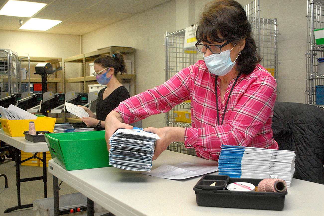 Clallam County election officials Nancy Buckner of Sequim, front, and Nicole Mischke of Port Angeles sort through special election ballots earlier today at the county courthouse in Port Angeles. (Keith Thorpe/Peninsula Daily News)