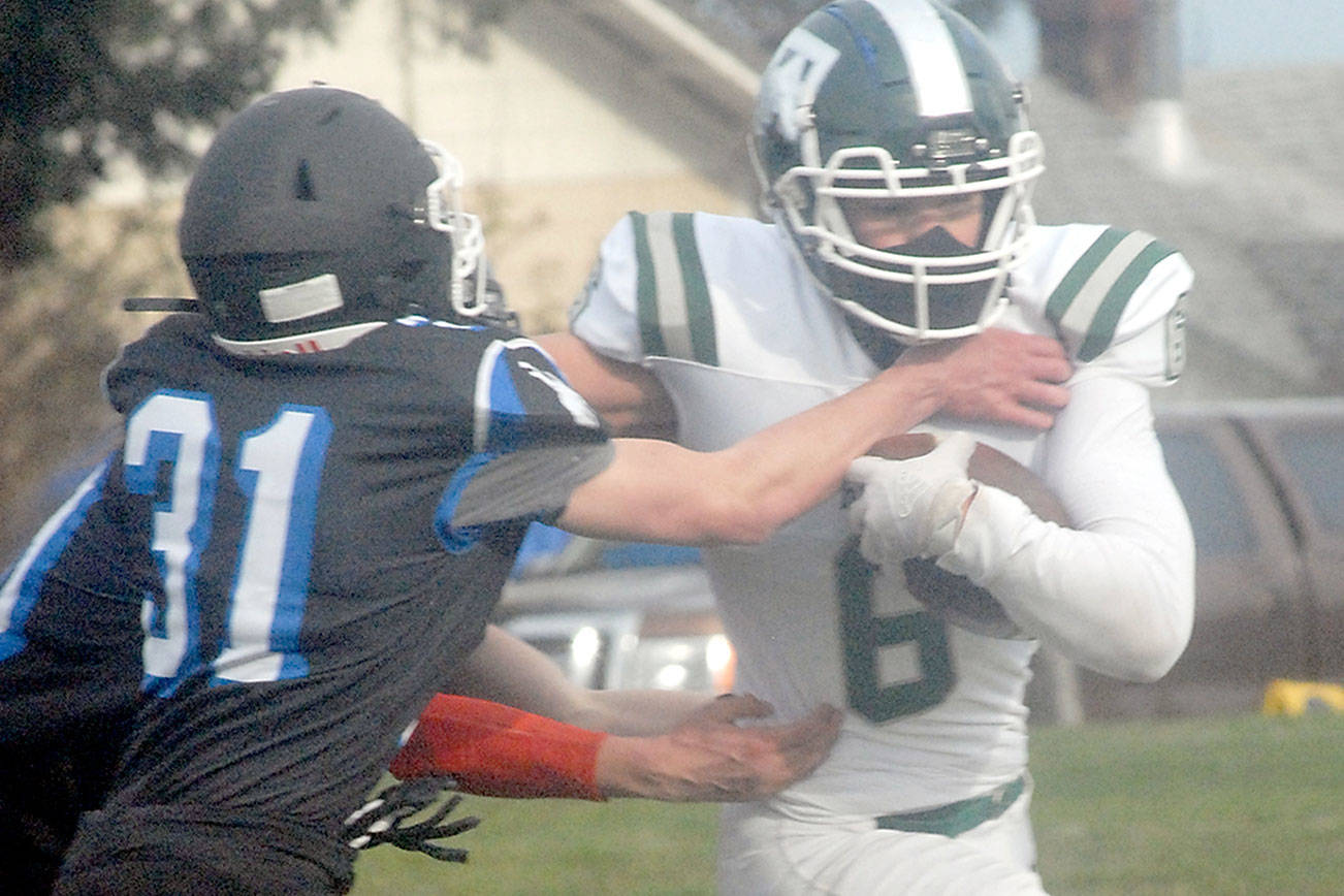 Keith Thorpe/Peninsula Daily News Port Angeles' Jaziel Livingston, right, tries to slip around the defense of East Jefferson's Nathan Nisbet on Saturday on the Stevens Middle School athletic field in Port Angeles.