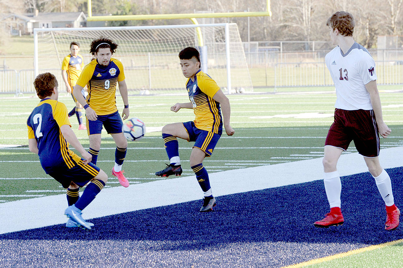 Spartans from left Juan Pablo Flores, Tony Flores-Hernandez and Andres Santos combine forces against Montesano on Tuesday at Spartan Stadium in Forks. (Lonnie Archibald/for Peninsula Daily News)