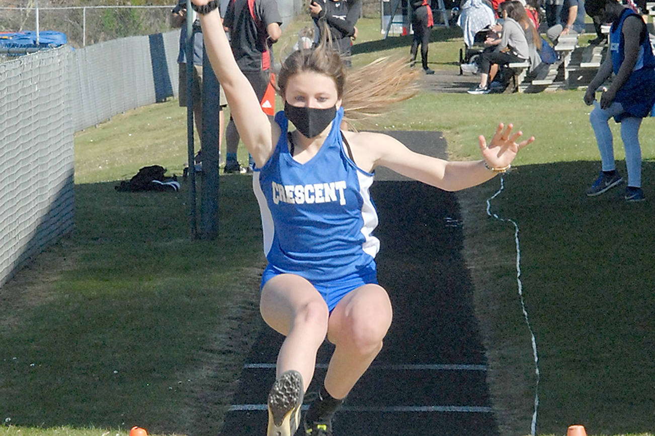 Keith Thorpe/Peninsula Daily News Crescent's Makiah Clark competes in the long jump on Friday in Joyce.