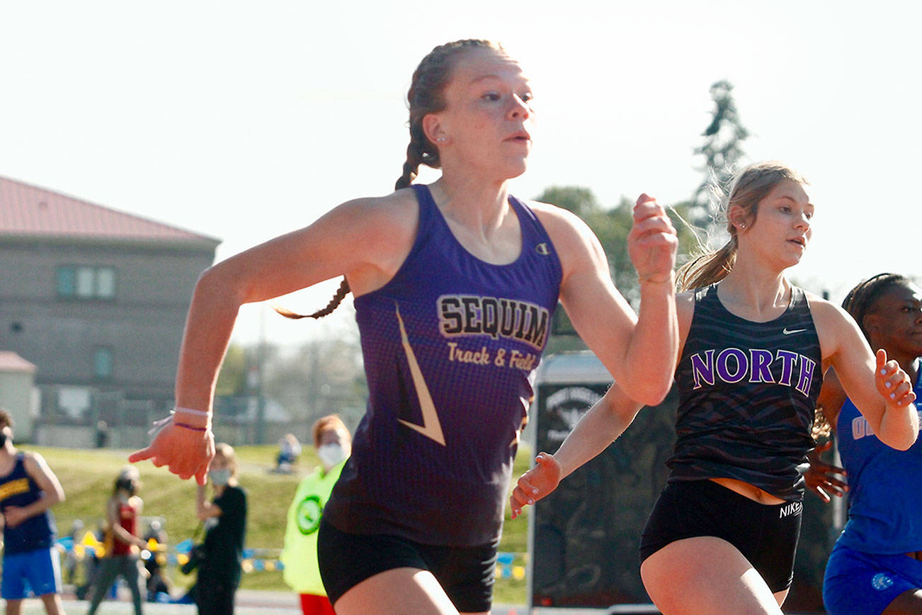 Mark Krulish/Kitsap News Group Sequim's Riley Pyeatt runs neck-and-neck with Lillian Pruden of North Kitsap in the 100-meter race. She finished second in the 100 but set a school record time in the 400 at the Class 1A/2A/3A Olympic League Championships at Bremerton High School.