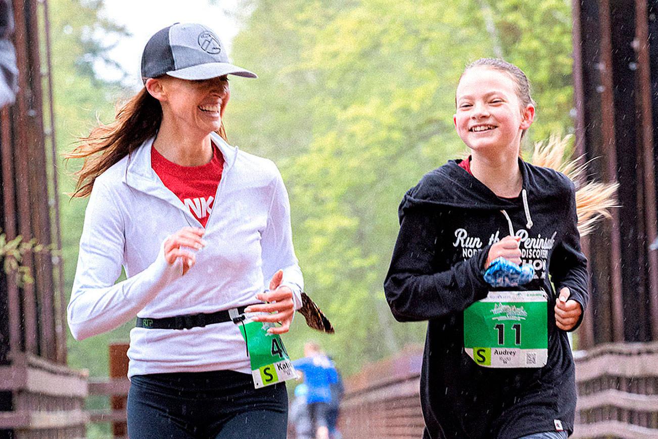 Port Angeles Marathon Association Mother and daughter, Katie and Audrey Rudd of Port Angeles, run in the 5K Railroad Bridge Run on Saturday.