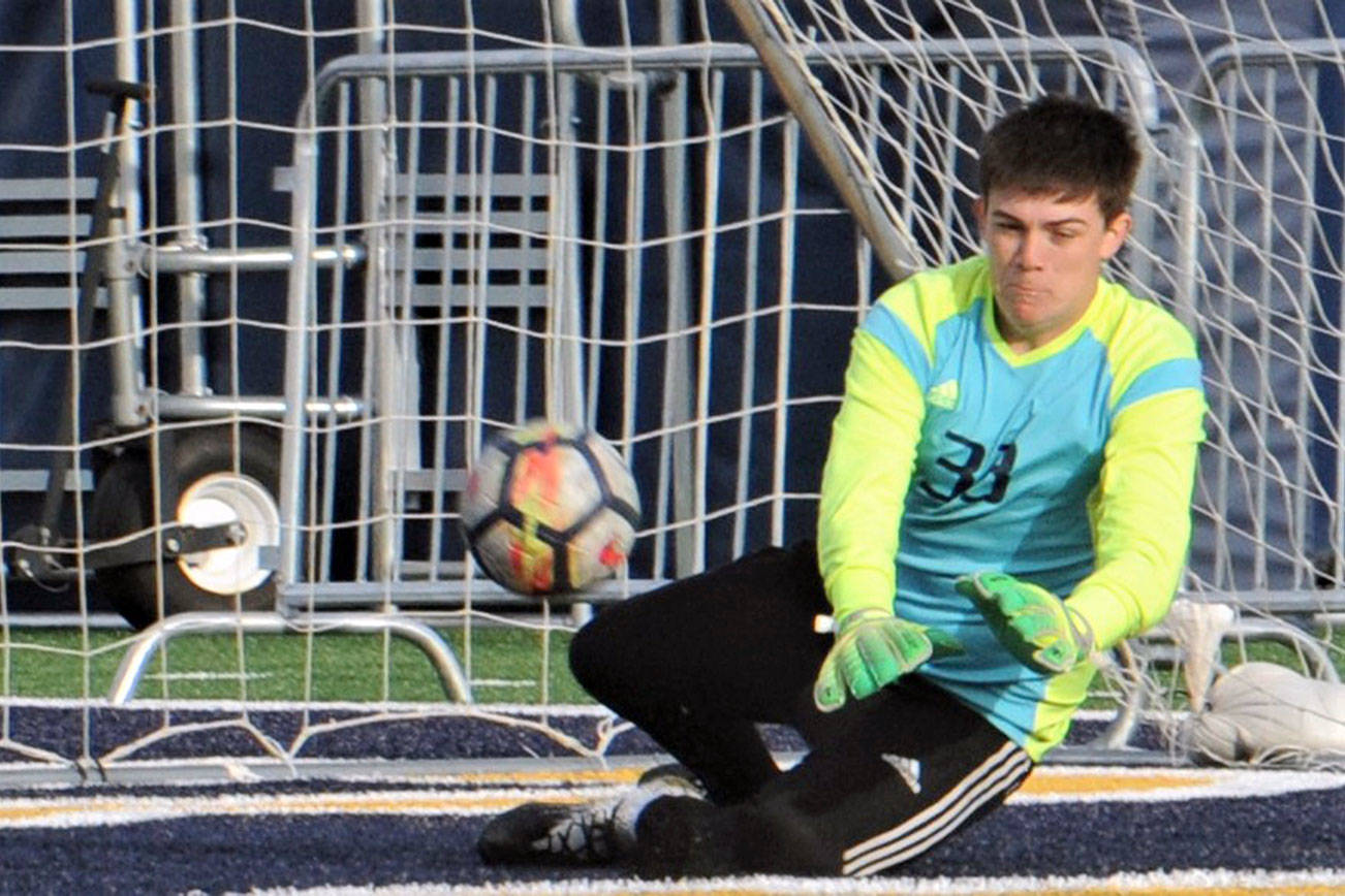 Lonnie Archibald/for Peninsula Daily News Forks goalkeeper Rafael Terrones saved a La Center penalty kick in the closing minutes to preserve the Spartans' 3-2 win over the Wildcats in the district semifinals.