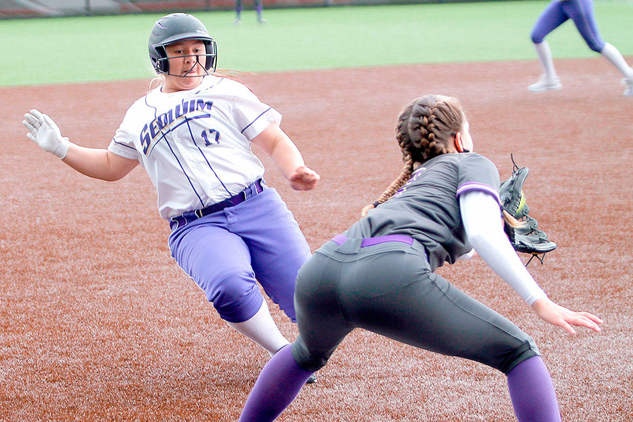 Sequim's Lily Fili slides into third base against North Kitsap on Saturday. (Mark Krulish/Kitsap News Group)