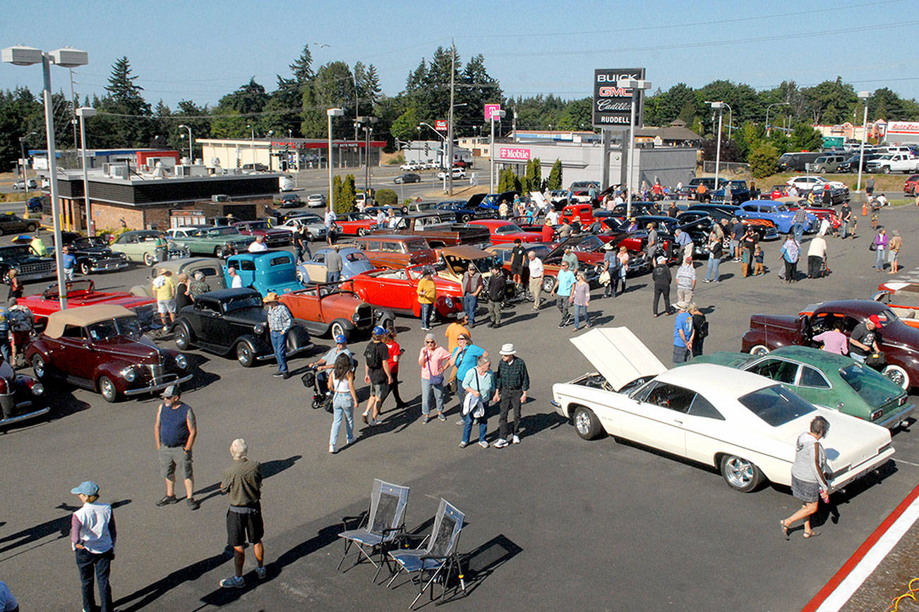 Keith Thorpe/Peninsula Daily News Vintage cars stand on display at Friday night's Ruddell Cruise In at Ruddell Auto Plaze in Port Angeles.