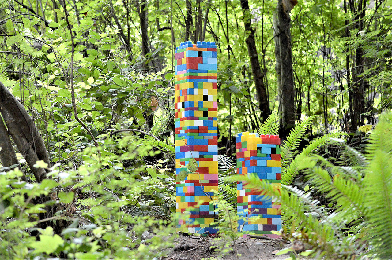 Michael Mills of Port Angeles' miniature skyscrapers are among the newer pieces in the Webster's Woods Sculpture Park. A guided tour of the 5-acre forest is open to the public Saturday. (Diane Urbani de la Paz/Peninsula Daily News)