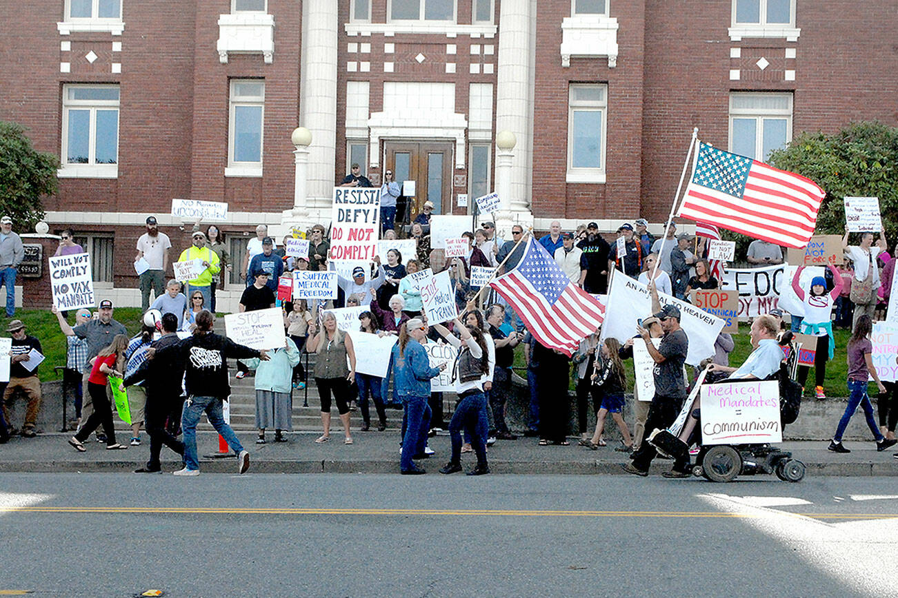 Mask mandate protesters gather in front of the Clallam County Courthouse in Port Angeles on Friday. (Keith Thorpe/Peninsula Daily News)