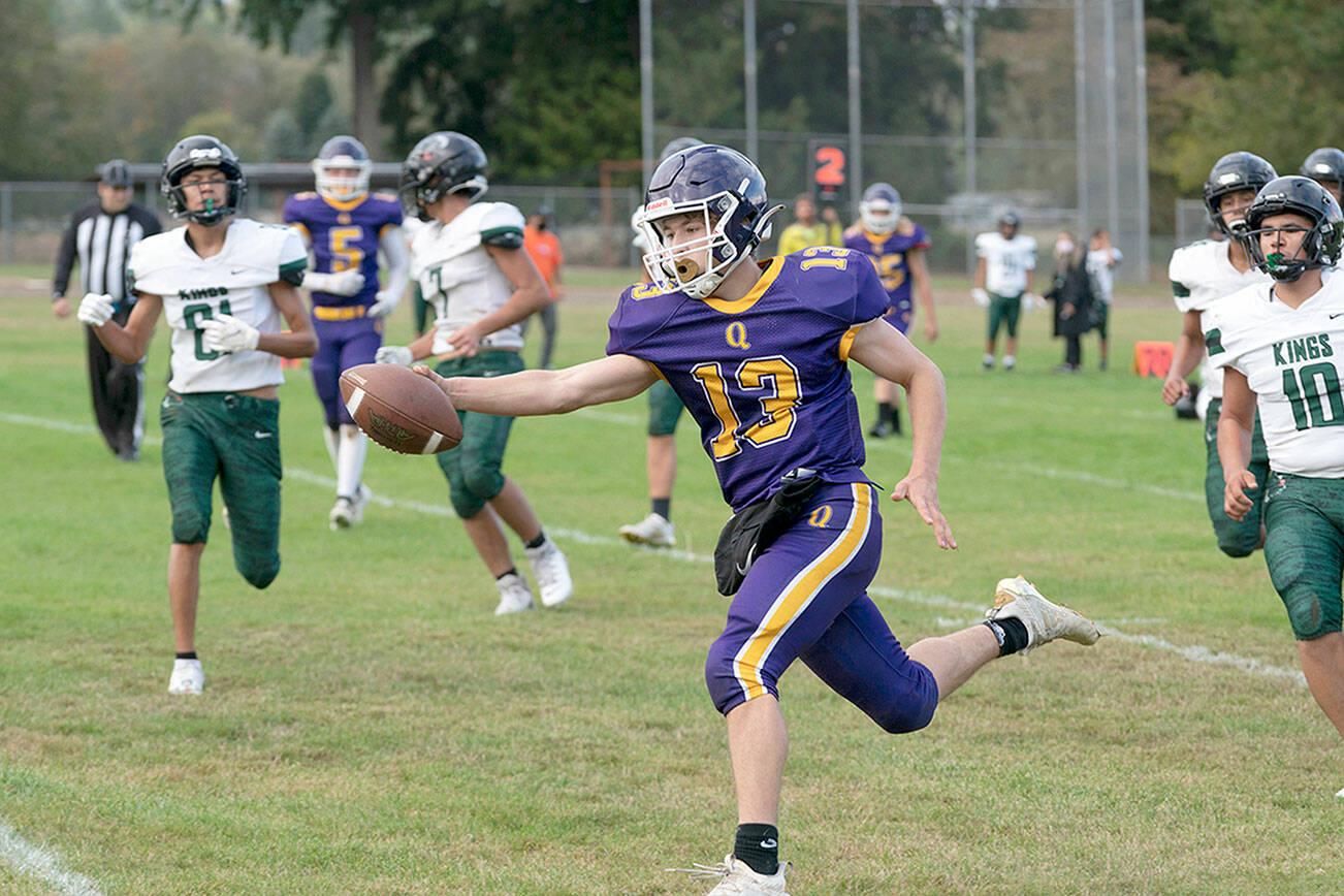 Steve Mullensky/for Peninsula Daily News   Ranger Kevin Alejo extends the ball over the plane of the goal line for a touchdown during a Thursday afternoon game home game against the Muckleshoot Kings.